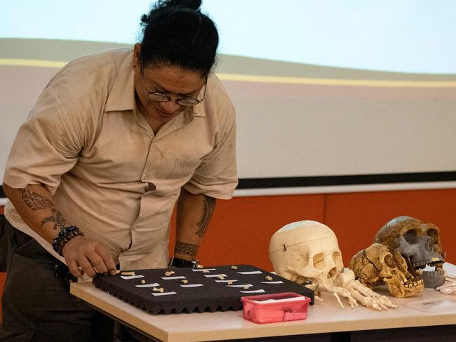 University of the Philippines (UP) Associate Professor Armand Salvador with fossils and teeth of a discovered new human species, the Homo luzonensis. Picture: AFP