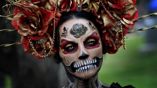 A woman dressed in a skeleton costume parades during the annual Dia de los Muertos (Day of the Dead) festival at the Hollywood Forever cemetery in Hollywood, California on October 29, 2016. Picture: AFP / Mark Ralston.