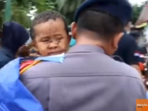 A young boy is pulled from the rubble after the tsunami hit in Indonesia. Picture: Storyful