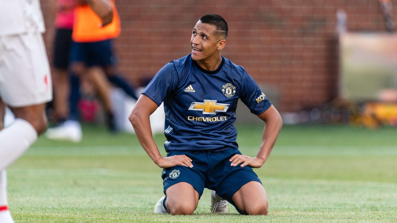 Alexis Sanchez reacts after missing a shot against Liverpool whilst wearing  United s new navy strip. eaf6c910c