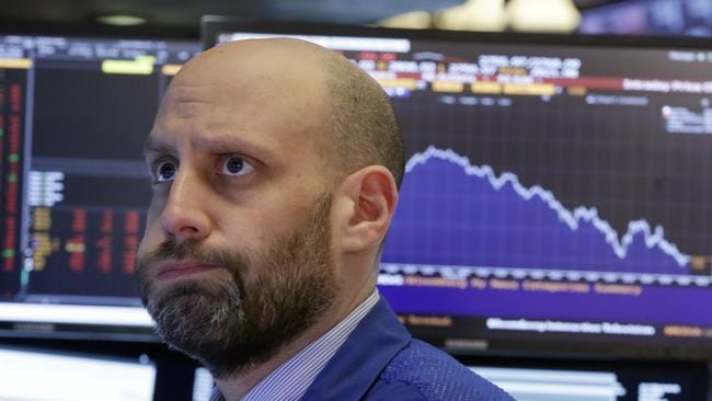 Specialist Meric Greenbaum works on the floor of the New York Stock Exchange and saw the Dow Jones drop more than 600 points. Picture: Richard Drew
