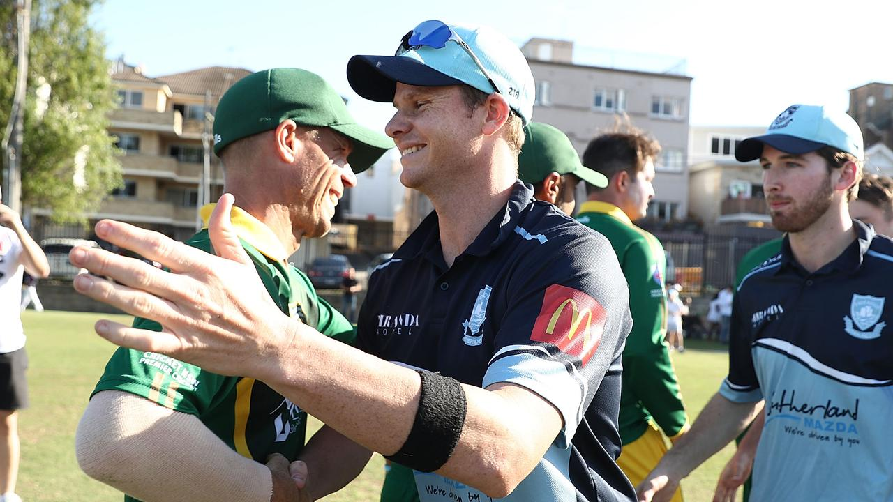 David Warner of Randwick-Petersham and Steve Smith of Sutherland embrace at the end of the Sydney Grade Cricket match at Coogee.