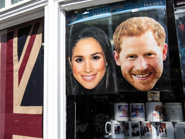Masks of Prince Harry and Meghan Markle sit in the window of a gift shop on May 10, 2018 in Windsor, England. Picture: Jack Taylor/Getty Images