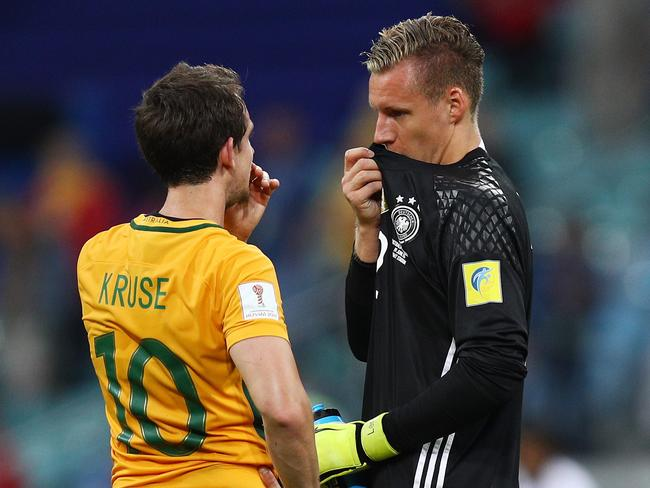 Robbie Kruse of Australia and Bernd Leno of Germany catch up.