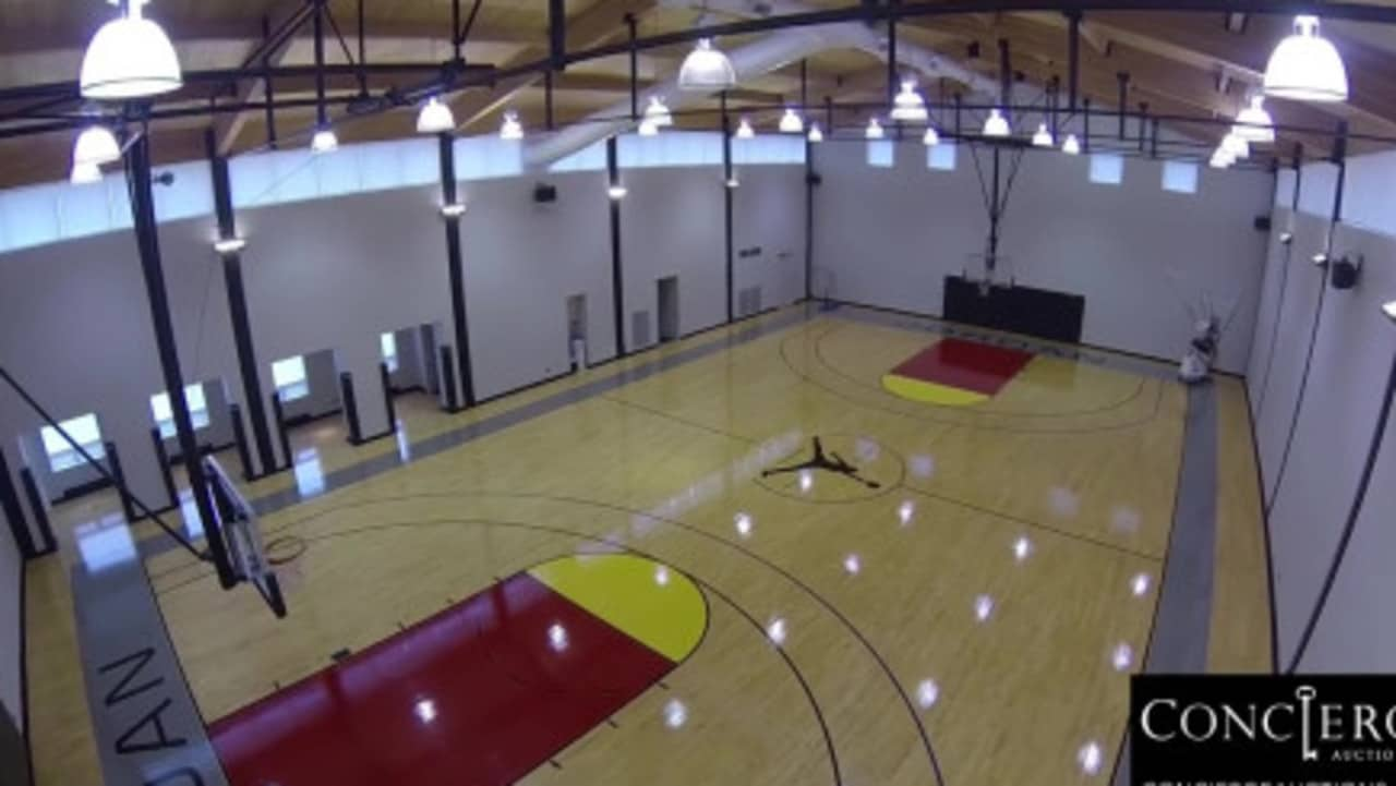 Jordan has his very own massive basketball court to finesse his skills in. Credit: Concierge Auctions