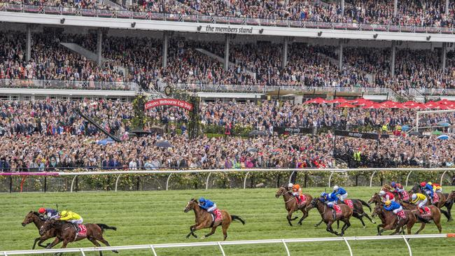 Almandin wins the Melbourne Cup with 100,000-odd punters looking on. Picture: Jason Edwards