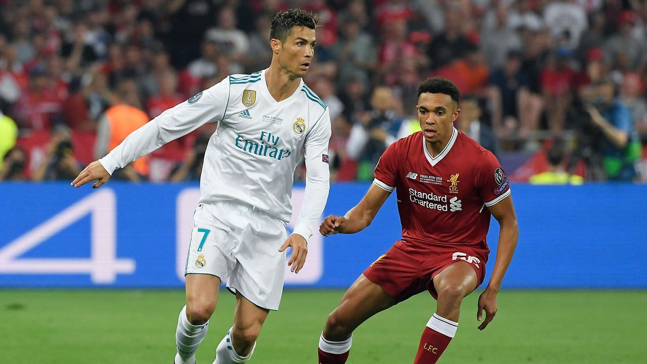 Alexander-Arnold holds off Cristiano Ronaldo during the Champions League final.
