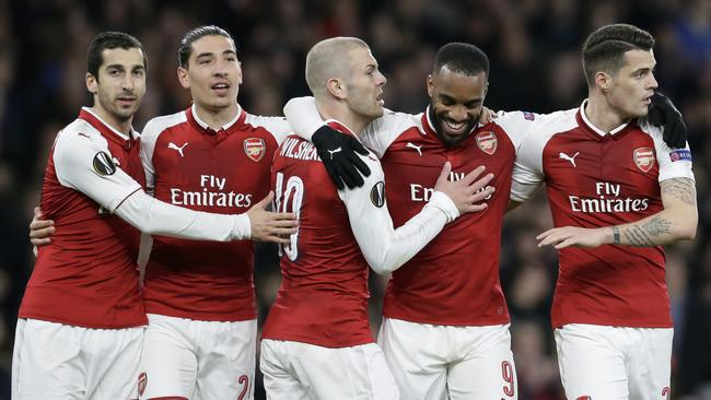Arsenal's Alexandre Lacazette, 2nd right, celebrates with teammates