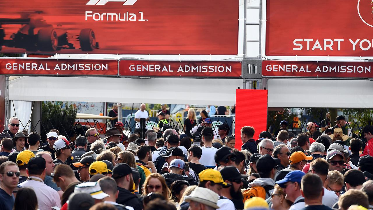 Fans queue up outside the gates prior to the Grand Prix's cancellation.