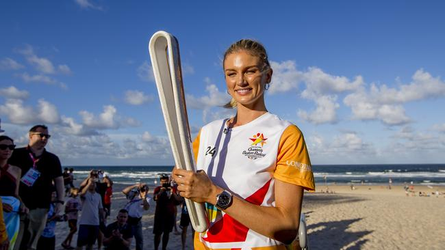 Amy Pejkovic's role in this year's Commonwealth Games has been restricted to carrying the Queen's baton after she suffered a knee injury. Picture: Jerad Williams