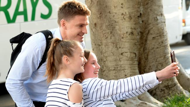 All Blacks star Beauden Barrett takes a photo with fans upon arrival at the Intercontinental Hotel.