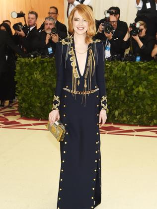 Emma Stone in a navy Louis Vuitton gown with gold detail at the Met Gala. Picture: Getty