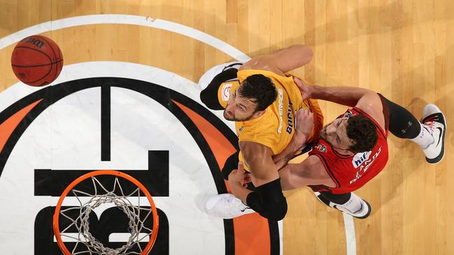 Andrew Bogut (L) and Angus Brandt eye off a rebound. Picture: Getty
