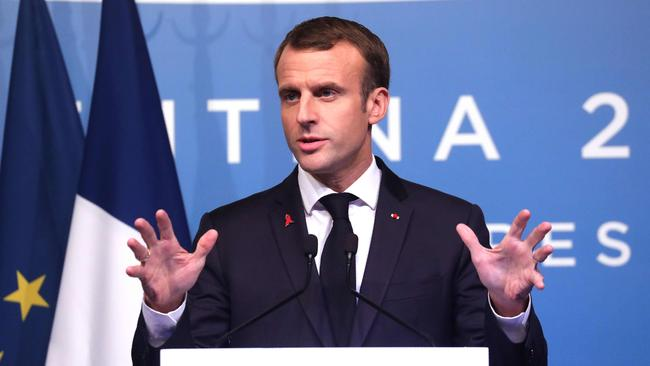 France's President Emmanuel Macron, delivering a press conference on the second day of the G20 Leader's Summit, in Buenos Aires, on December 1 as riots raged in France. Picture: AP