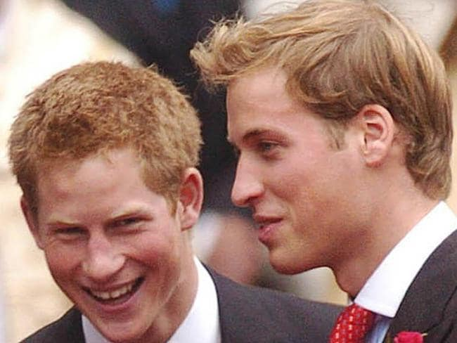 In happier times ... Prince Harry (left) and Prince William share a laugh in their younger days. Picture: Getty