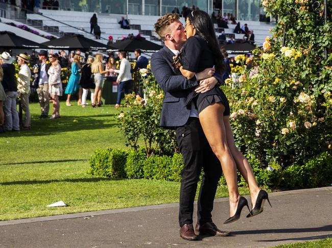 Two happy punters share a kiss after the race. Picture: Jenny Evans/Getty Images
