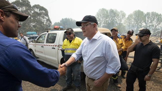 Prime Minister Scott Morrison meets with NSW RFS volunteers in the Blue Mountains. Picture: Wolter Peeters