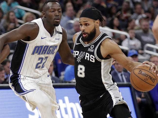 San Antonio Spurs' Patty Mills (right) drives around Orlando Magic's Jerian Grant during the second half of a recent NBA basketball game.
