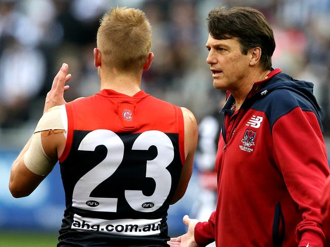 Vince chats with coach Paul Roos. Picture: Wayne Ludbey