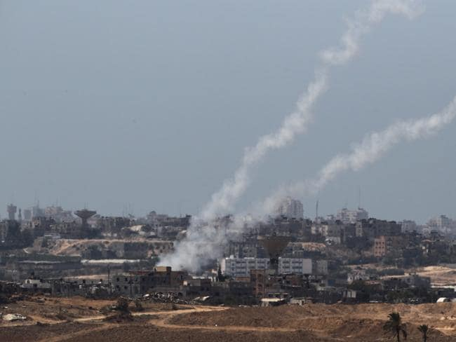 "Attacks ... a picture taken from the Israeli side of the Israel-Gaza Border shows rockets being fired by Palestinian militants from the Gaza strip into Israel. Arab League chief Nabil al-Arabi accuses Israel of ""blocking"" all attempts to end the Gaza conflict, a day after the collapse of a ceasefire in the Palestinian territory. Picture: AFP"