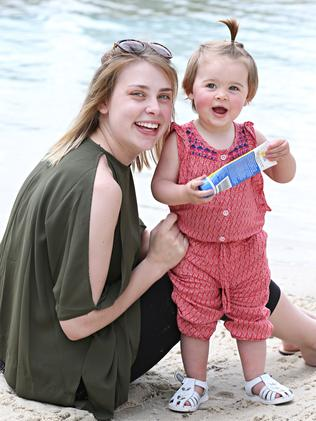Hope Medcraft, 23, is vigilant about applying sunscreen to her one-year-old daughter, Indeah Young. Picture: Annette Dew
