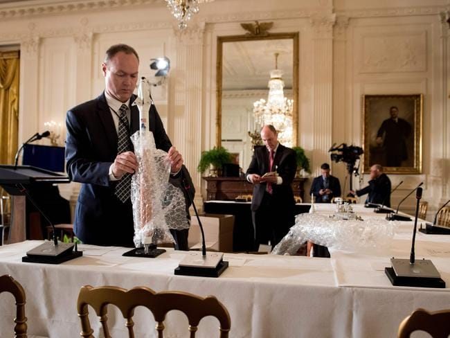 Models of space craft and other NASA objects are unpacked before an event with the space council at the White House. Picture: AFP