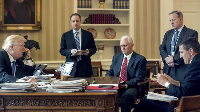 President Donald Trump accompanied by Chief of Staff Reince Priebus, Vice President Mike Pence, White House press secretary Sean Spicer and National Security Adviser Michael Flynn speaks on the phone with Russian President Vladimir Putin in the Oval Office at the White House in Washington in January 2017. Picture: AP /Andrew Harnik.