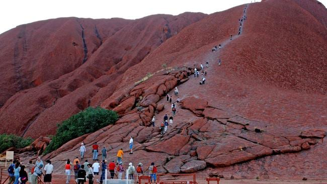 Although it's against the wishes of the traditional owners, tourists still climb Uluru. Picture: AAP Image/Terry Trewin