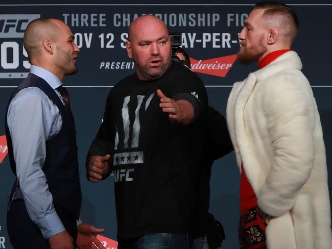 Dana White separates Eddie Alvarez and Conor McGregor during the UFC 205 press conference.