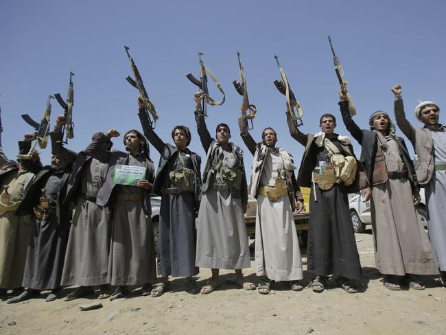 Shiite Houthi tribesmen hold their weapons as they chant slogans during a tribal gathering showing support for the Houthi movement. Picture: AP/Hani Mohammed