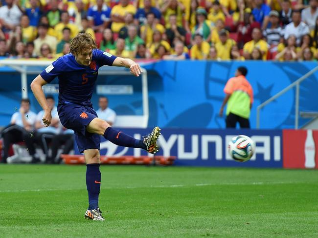 Daley Blind of the Netherlands scores his team's second goal during the 2014 FIFA World Cup third place playoff against Brazil.