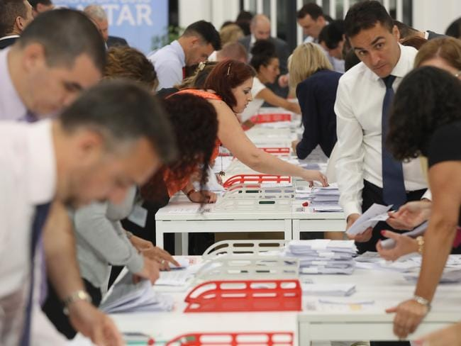 Referendum workers at Gibraltar University count ballots after the closing of polling stations an hour before mainland Britain.