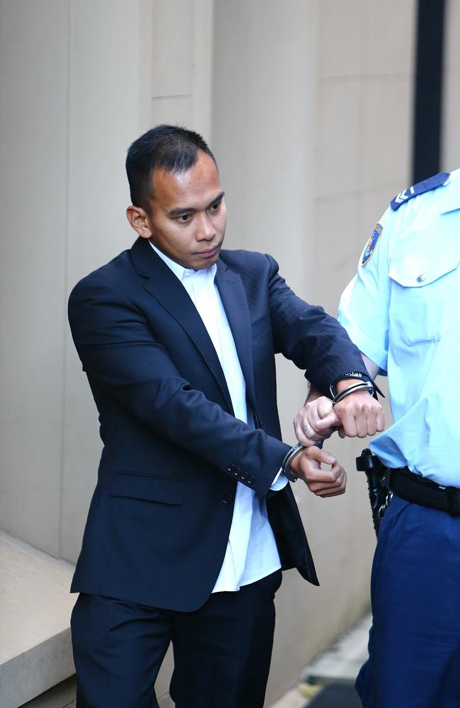 Roy Abanales Tabalbag, being led out of court during his murder trial at the NSW Supreme Court in Sydney.