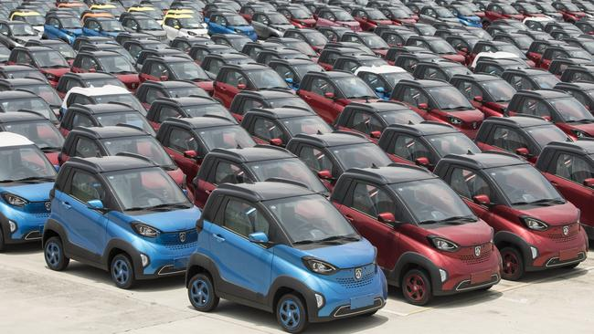 Baojun E100 electric vehicles sit parked in the parking lot of the SAIC-GM-Wuling Automobile Co Baojun Base plant, a joint venture between SAIC Motor Corp, General Motors Co and Liuzhou Wuling Automobile Industry Co in Liuzhou, Guangxi province, China. Picture: Qilai Shen/Bloomberg