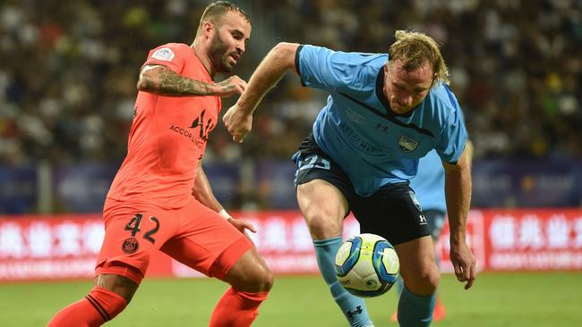 Sydney FC's Rhyan Grant gets to the ball ahead of Paris Saint Germain's Jose Rodriguez. Picture: AFP