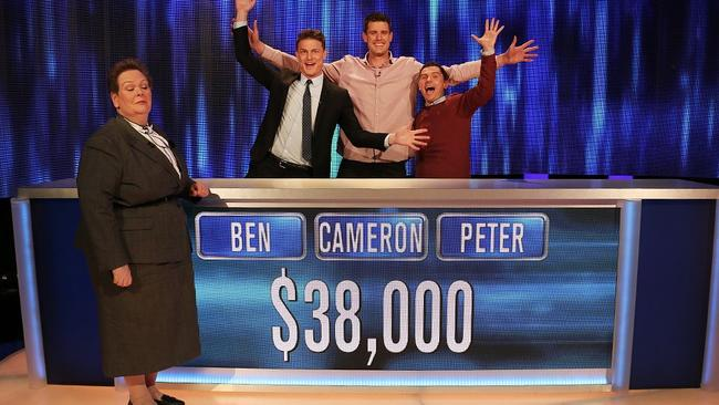 Former AFL ruckman Cameron Wood celebrates with fellow contestants after winning on The Chase Australia.