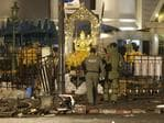 Explosive Ordnance Disposal officers move in. (AP Photo/Sackchai Lalit)