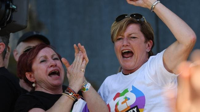 YES! Virginia Edwards (left) and Christine Forster celebrate after watching the same-sex marriage vote result announcement. Picture: AAP/David Moir
