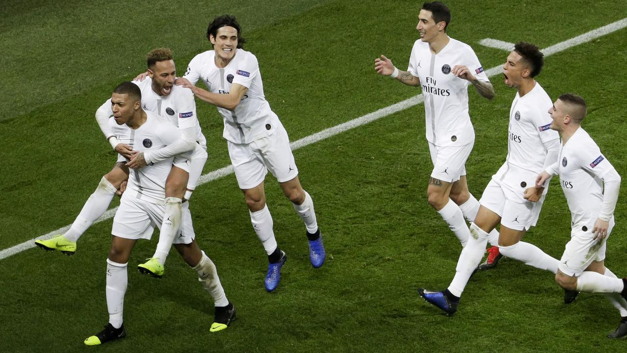 Paris Saint-Germain's Brazilian forward Neymar celebrates Kylian Mbappe and teammates after scoring