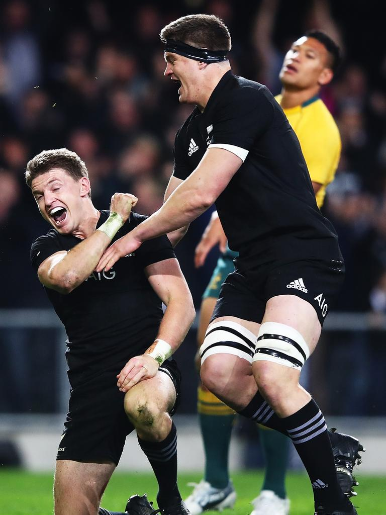 Beauden Barrett of the All Blacks celebrates with brother Scott after scoring the winning try.