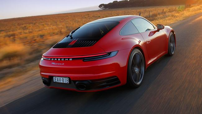 The 911's silhouette is unmistakeable.