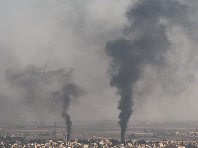 Smoke rises over the Syrian town of Ras al-Ain after Turkish attacks. Picture: Burak Kara/Getty Images.