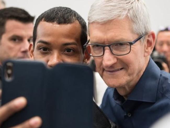Apple CEO Tim Cook posing for a selfie with a fan at new iPhone XS release. Picture: Jennifer Dudley-Nicholson