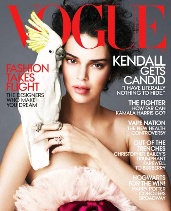 Kendall Jenner appears on the April 2018 issue of US Vogue with a cockatoo. Picture: Vogue