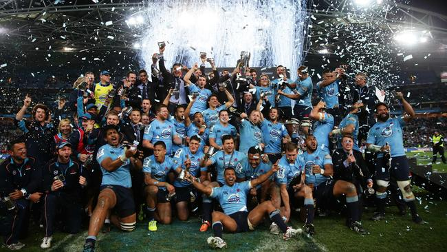 The Waratahs celebrate winning the Super Rugby final. Picture: Brett Costello