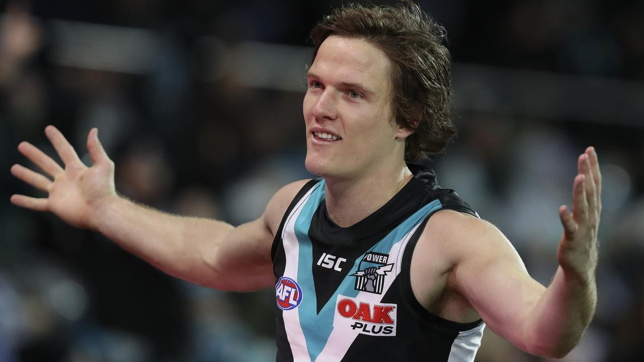 Jared Polec celebrates his goal with the crowd this season.