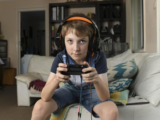 Tom Benhiam, 11, is all obsessed with the Hunger Games-style video game Fortnite: Battle Royale. Picture: Darren Leigh Roberts