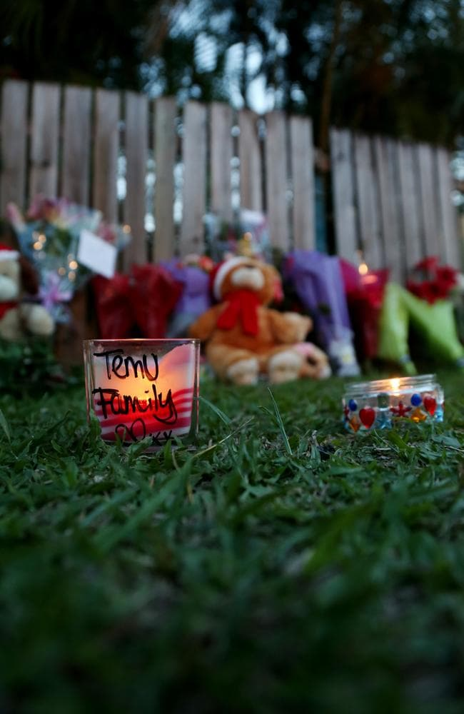 Flowers, teddies, and candles left outside the Cairns home. Picture: Stewart McLean