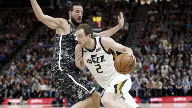 Utah Jazz forward Joe Ingles drives around San Antonio Spurs centre Joffrey Lauvergne.