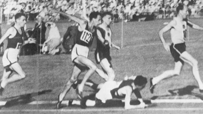 John Landy attempts to jump Ron Clarke before returning to help him up. Picture: supplied